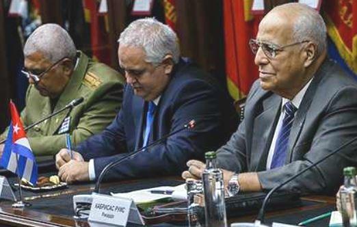 The Cuban side included, from right, Ricardo Cabrisas; Ambassador Emilio Losada; an unidentified Cuban officer.