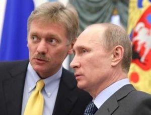 Kremlin spokesman Dmitri Peskov and President Vladimir Putin.